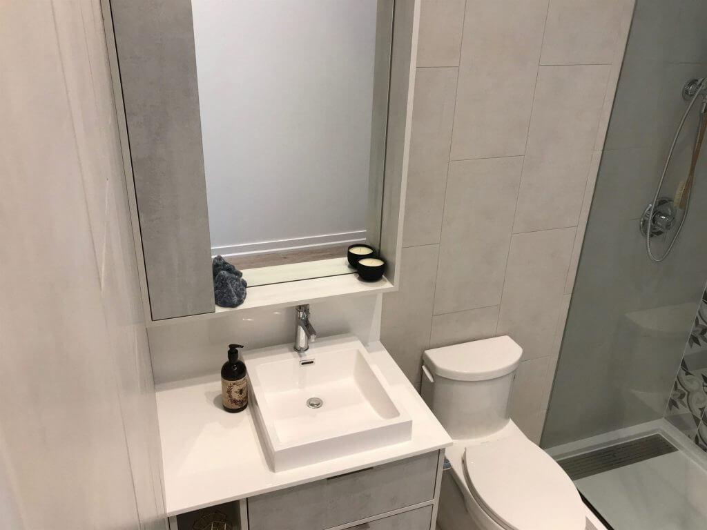 white tiles bath room